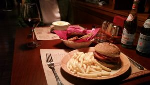 A massive burger with a heap of fries from Asador Steak House in Irkutsk