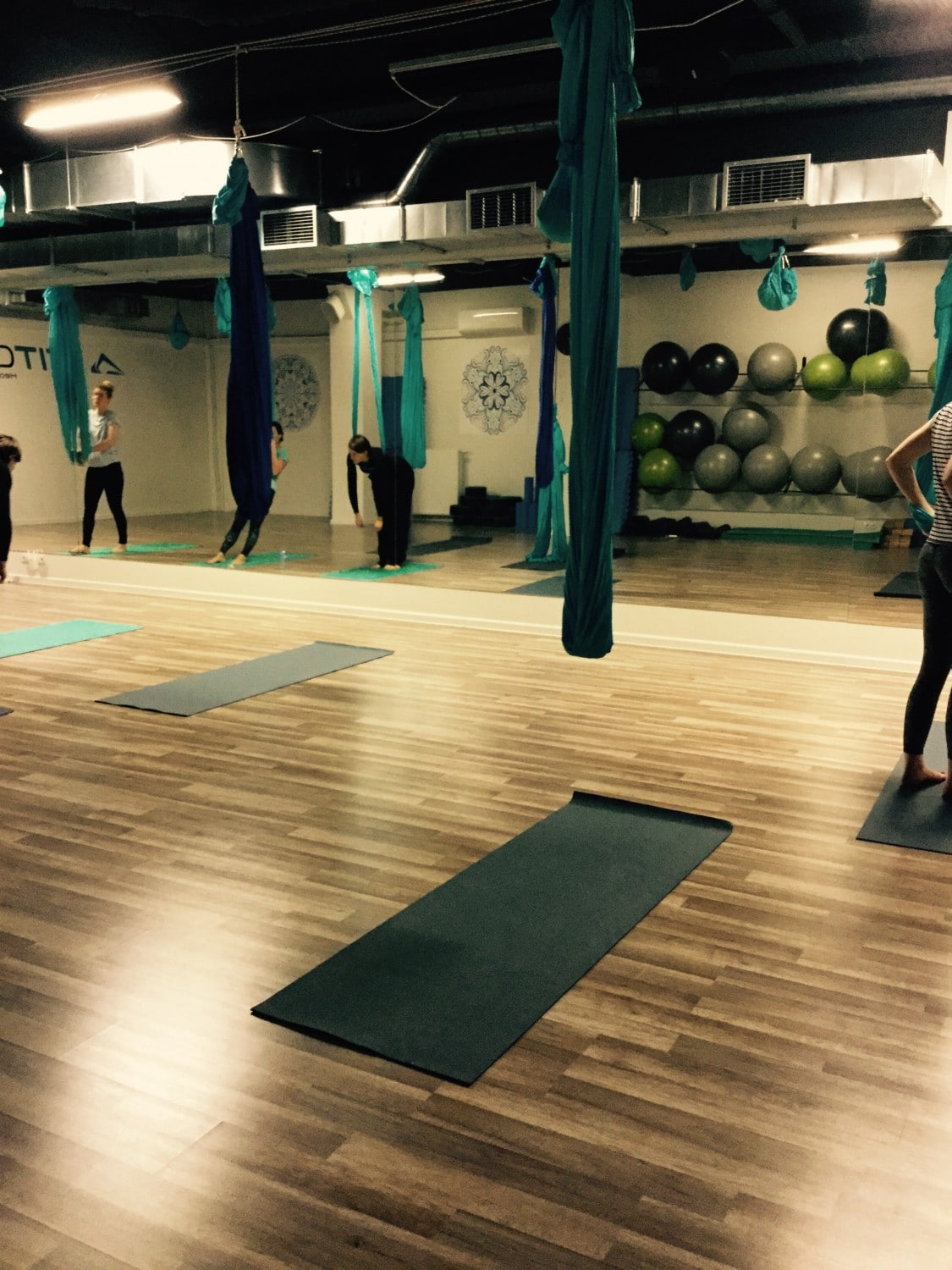 Inside Fitology's aerial yoga class.